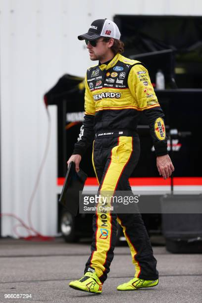 Ryan Blaney driver of the Menards/Duracell Ford walks through the garage area during practice for the Monster Energy NASCAR Cup Series Pocono 400 at...