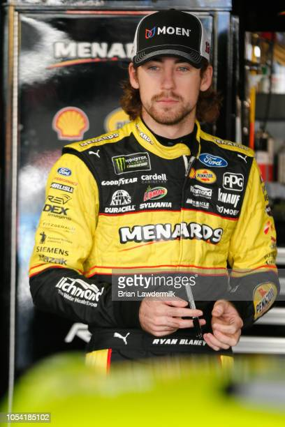 Ryan Blaney driver of the Menards/Moen Ford stands in the garage area during practice for the Monster Energy NASCAR Cup Series First Data 500 at...