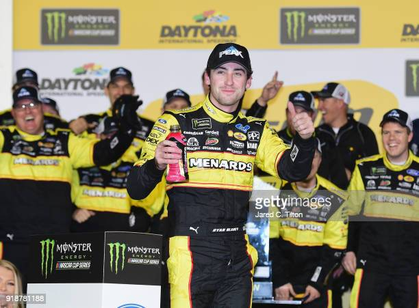 Ryan Blaney driver of the Menards/Peak Ford celebrates in Victory Lane after winning the Monster Energy NASCAR Cup Series CanAm Duel 1 at Daytona...