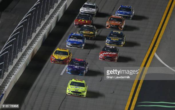 Ryan Blaney driver of the Menards/Peak Ford leads a pack of cars during the Monster Energy NASCAR Cup Series CanAm Duel 1 at Daytona International...