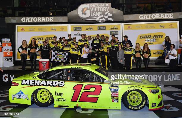 Ryan Blaney driver of the Menards/Peak Ford poses with the trophy in Victory Lane after winning the Monster Energy NASCAR Cup Series CanAm Duel 1 at...