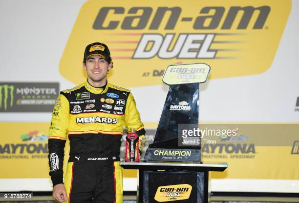 Ryan Blaney driver of the Menards/Peak Ford poses with the trophy during the Monster Energy NASCAR Cup Series CanAm Duel 1 at Daytona International...