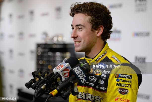 Ryan Blaney driver of the Menards/Peak Ford speaks with the media during the Daytona 500 Media Day at Daytona International Speedway on February 14...