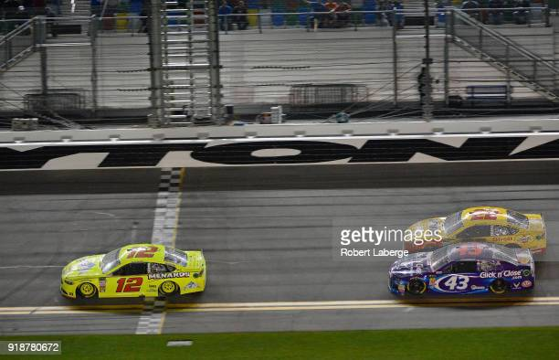 Ryan Blaney driver of the Menards/Peak Ford takes the checkered flag to win the Monster Energy NASCAR Cup Series CanAm Duel 1 at Daytona...