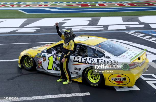 Ryan Blaney driver of the Menards/Pennzoil Ford celebrates after winning the Monster Energy NASCAR Cup Series Bank of America Roval 400 at Charlotte...
