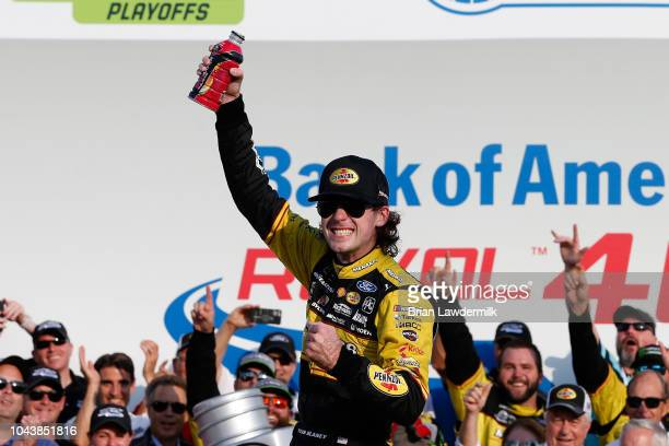 Ryan Blaney driver of the Menards/Pennzoil Ford celebrates in Victory Lane after winning the Monster Energy NASCAR Cup Series Bank of America Roval...