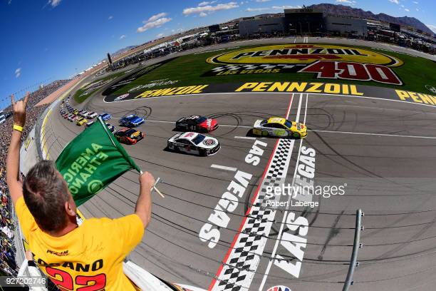 Ryan Blaney driver of the Menards/Pennzoil Ford takes the green flag to start the Monster Energy NASCAR Cup Series Pennzoil 400 presented by Jiffy...