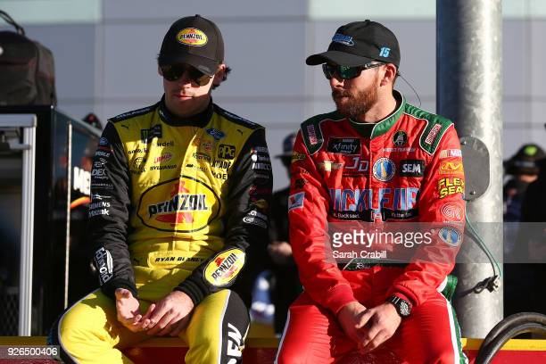 Ryan Blaney driver of the Menards/Pennzoil Ford talk to Ross Chastain driver of the LowT Center Chevrolet during qualifying for the Monster Energy...
