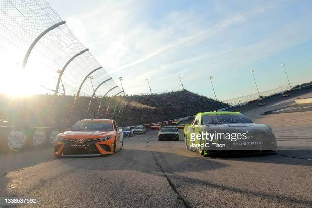Ryan Blaney, driver of the Menards/Richmond Ford, and Denny Hamlin, driver of the Offerpad Toyota lead the field on a pace lap prior to the NASCAR...