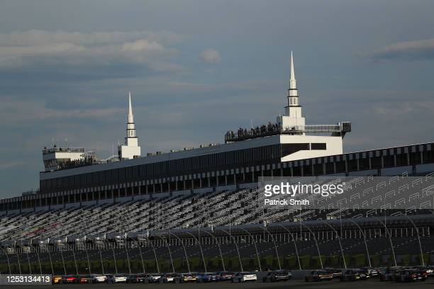 Ryan Blaney, driver of the Menards/Richmond Ford, leads the field to a restart during the NASCAR Cup Series Pocono 350 at Pocono Raceway on June 28,...