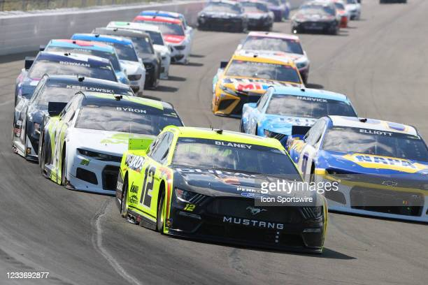 Ryan Blaney, driver of the Menards/Richmond Team Penske Ford drives into turn 1 during the NASCAR Cup Series - Explore the Pocono Mountains 350 on...