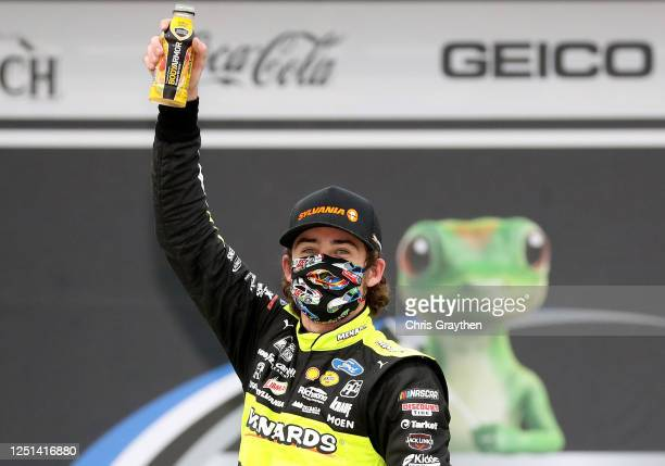 Ryan Blaney driver of the Menards/Sylvania Ford celebrates in Victory Lane after winning the NASCAR Cup Series GEICO 500 at Talladega Superspeedway...
