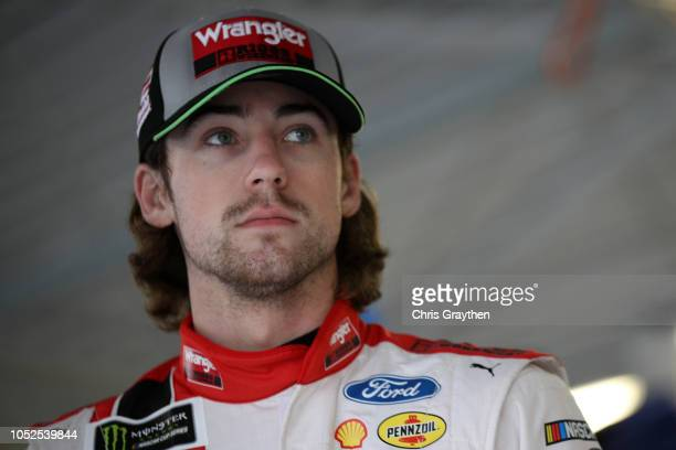 Ryan Blaney driver of the Menards/Wrangler Riggs Workwear Ford stands in the garage area during practice for the Monster Energy NASCAR Cup Series...