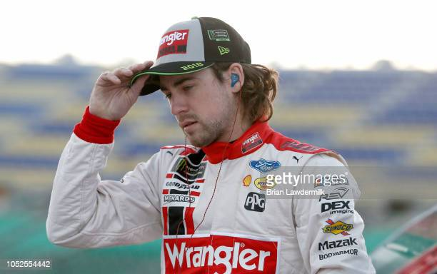 Ryan Blaney driver of the Menards/Wrangler Riggs Workwear Ford stands on the grid during qualifying for the Monster Energy NASCAR Cup Series...