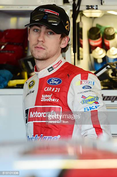 Ryan Blaney driver of the Motorcraft / Quick Lane Tire Auto Center Ford stands in the garage area during practice for the NASCAR Sprint Cup Series...