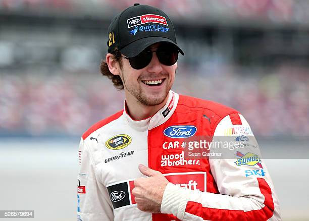 Ryan Blaney driver of the Motorcraft/Quick Lane Tire Auto Center Ford stands on the grid during qualifying for the NASCAR Sprint Cup Series GEICO 500...