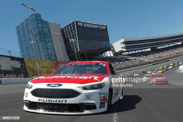 Ryan Blaney driver of the Motorcraft/Quick Lane Tire Auto Center Ford leads the field at the start of the Monster Energy NASCAR Cup Series O'Reilly...