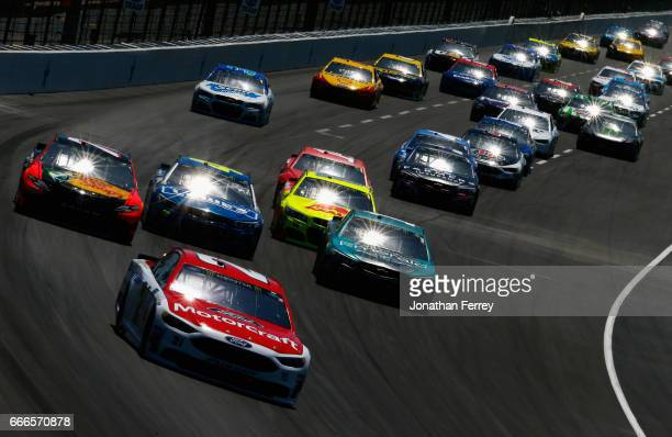 Ryan Blaney driver of the Motorcraft/Quick Lane Tire Auto Center Ford leads a pack of cars during the Monster Energy NASCAR Cup Series O'Reilly Auto...