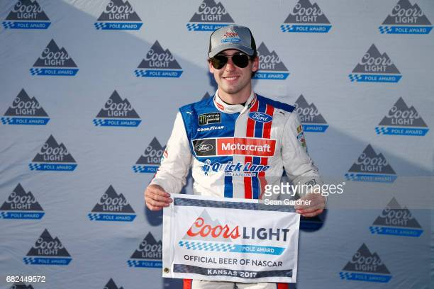Ryan Blaney driver of the Motorcraft/Quick Lane Tire Auto Center Ford poses for a photo after winning the pole award for the Monster Energy NASCAR...