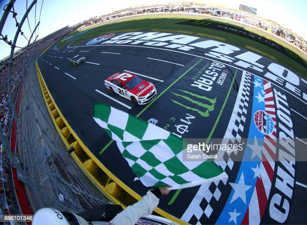 Ryan Blaney driver of the Motorcraft/Quick Lane Tire Auto Center Ford takes the checkered flag to win Stage 2 of the Monster Energy NASCAR Open at...