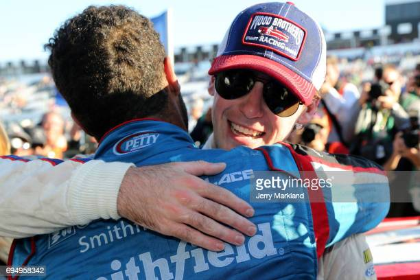 Ryan Blaney driver of the Motorcraft/Quick Lane Tire Auto Center Ford is congratulated by Darrell Wallace Jr driver of the Smithfield Ford in Victory...