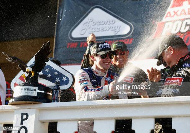 Ryan Blaney driver of the Motorcraft/Quick Lane Tire Auto Center Ford celebrates in Victory Lane after winning the Monster Energy NASCAR Cup Series...