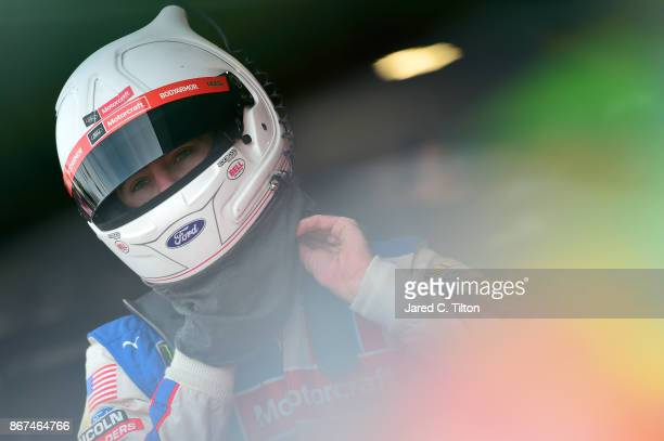 Ryan Blaney driver of the Motorcraft/Quick Lane Tire Auto Center Ford stands in the garage area before practice for the Monster Energy NASCAR Cup...