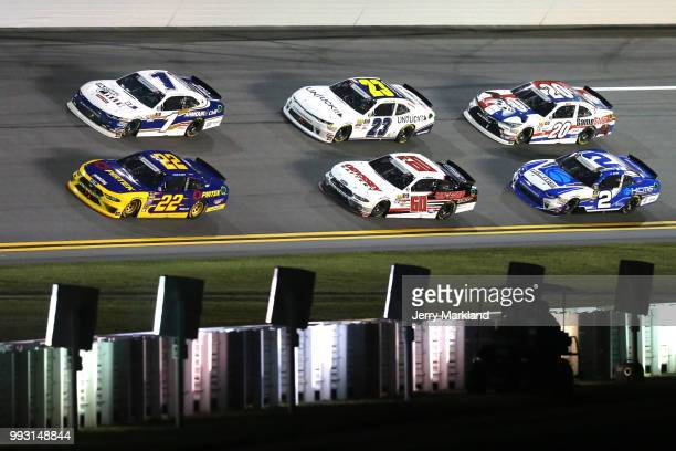 Ryan Blaney driver of the Pirtek Ford and Elliott Sadler driver of the ARMOUR Chili Chevrolet lead a pack of cars during the NASCAR Xfinity Series...