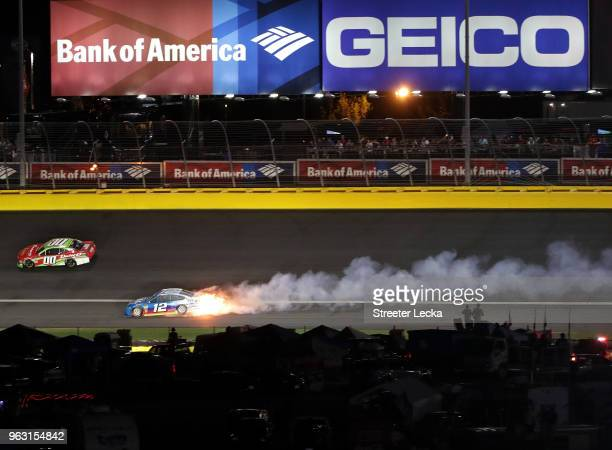 Ryan Blaney driver of the PPG Ford is involved in an ontrack incident during the Monster Energy NASCAR Cup Series CocaCola 600 at Charlotte Motor...