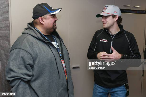 Ryan Blaney driver of the PPG Ford meets comedian Gabriel Iglesias prior to the Monster Energy NASCAR Cup Series Auto Club 400 at Auto Club Speedway...