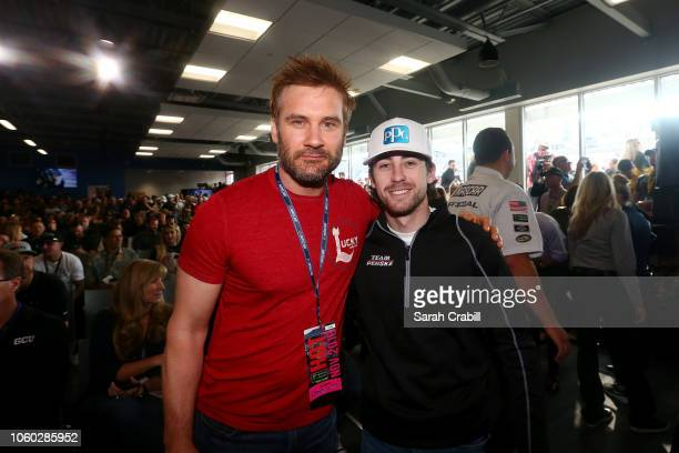 Ryan Blaney driver of the PPG Ford meets with actor Clive Standen at the driver's meeting prior to the Monster Energy NASCAR Cup Series CanAm 500 at...