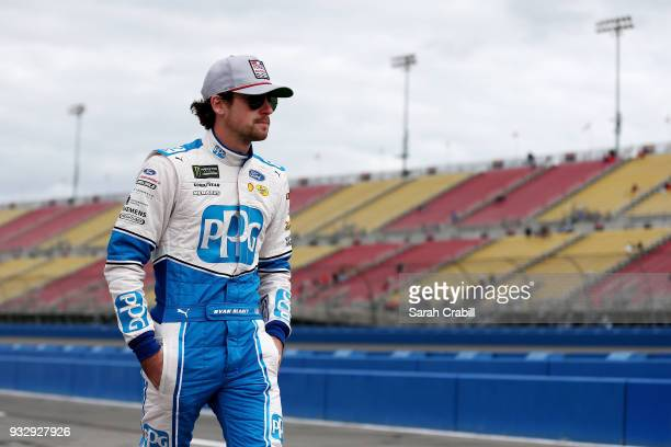 Ryan Blaney driver of the PPG Ford walks on the grid during qualifying for the Monster Energy NASCAR Cup Series Auto Club 400 at Auto Club Speedway...
