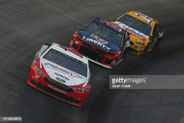 Ryan Blaney driver of the REV Ford leads Clint Bowyer driver of the Rush Truck Centers/Cummins Ford and William Byron driver of the Liberty...
