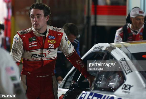 Ryan Blaney driver of the REV Group Ford reacts in the garage after an ontrack incident during the Monster Energy NASCAR Cup Series KC Masterpiece...