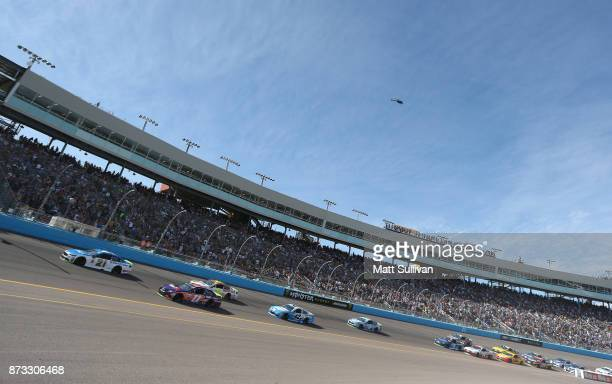Ryan Blaney driver of the SKF/Quick Lane Tire Auto Center Ford and Denny Hamlin driver of the FedEx Ground Toyota lead the field at the start of the...