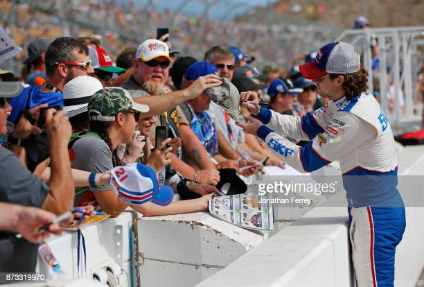 Ryan Blaney driver of the SKF/Quick Lane Tire Auto Center Ford signs autographs prior to the Monster Energy NASCAR Cup Series CanAm 500 at Phoenix...
