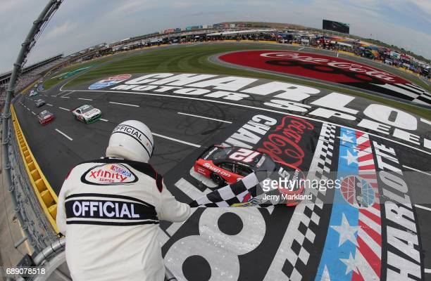 Ryan Blaney driver of the SnapOn Ford taks the checkered flag to win the NASCAR Xfinity Series Hisense 4K TV 300 at Charlotte Motor Speedway on May...