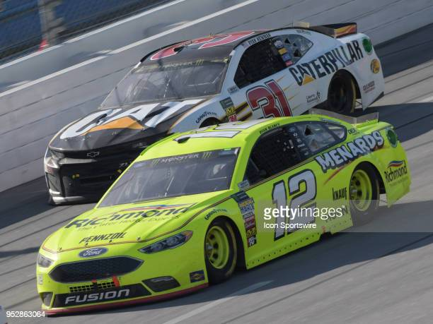 Ryan Blaney Team Penske Ford Fusion Menards/Richmond and Ryan Newman Richard Childress Racing Chevrolet Camaro Caterpillar race side by side during...