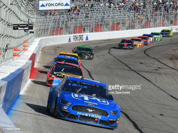 Ryan Blaney, Team Penske, Ford Mustang PPG races into turn one during the Monster Energy Cup Series Folds of Honor QuikTrip 500 on February 24 at...