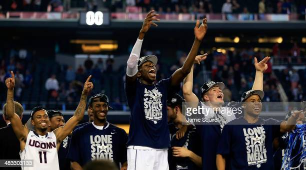 Ryan Boatright, Lasan Kromah, Amida Brimah, and Tyler Olander of the Connecticut Huskies celebrate on stage after defeating the Kentucky Wildcats...