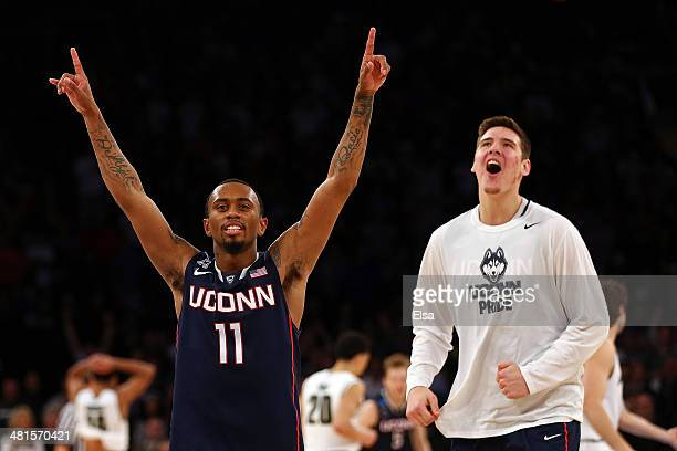 Ryan Boatright of the Connecticut Huskies celebrates after defeating the Michigan State Spartans during the East Regional Final of the 2014 NCAA...