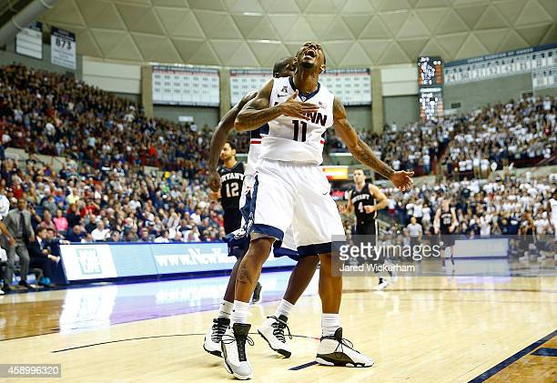 Ryan Boatright of the Connecticut Huskies celebrates following a dunk in the second half against the Byrant Bulldogs during the game at Harry A...