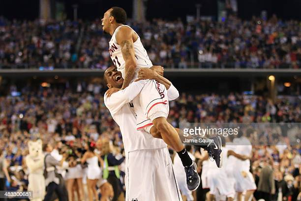 Ryan Boatright of the Connecticut Huskies celebrates with a teammate after defeating the Kentucky Wildcats 60-54 in the NCAA Men's Final Four...