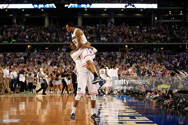 Ryan Boatright of the Connecticut Huskies celebrates with a teammate after defeating the Kentucky Wildcats 6054 in the NCAA Men's Final Four...
