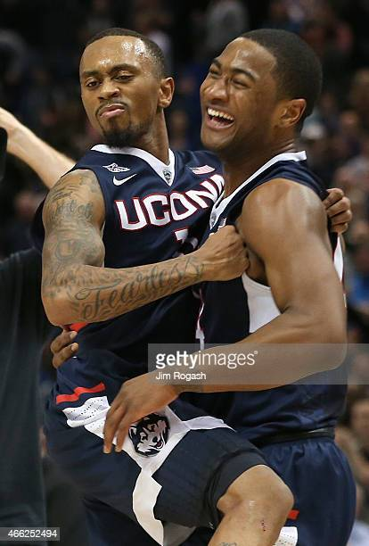 Ryan Boatright of the Connecticut Huskies celebrates with Rodney Purvis after defeating Tulsa Golden Hurricanes during the semifinal game of the 2015...