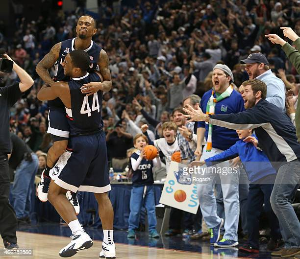 Ryan Boatright of the Connecticut Huskies celebrates with Rodney Purvis after defeating Tulsa Golden Hurricanes during a semifinal game of the 2015...