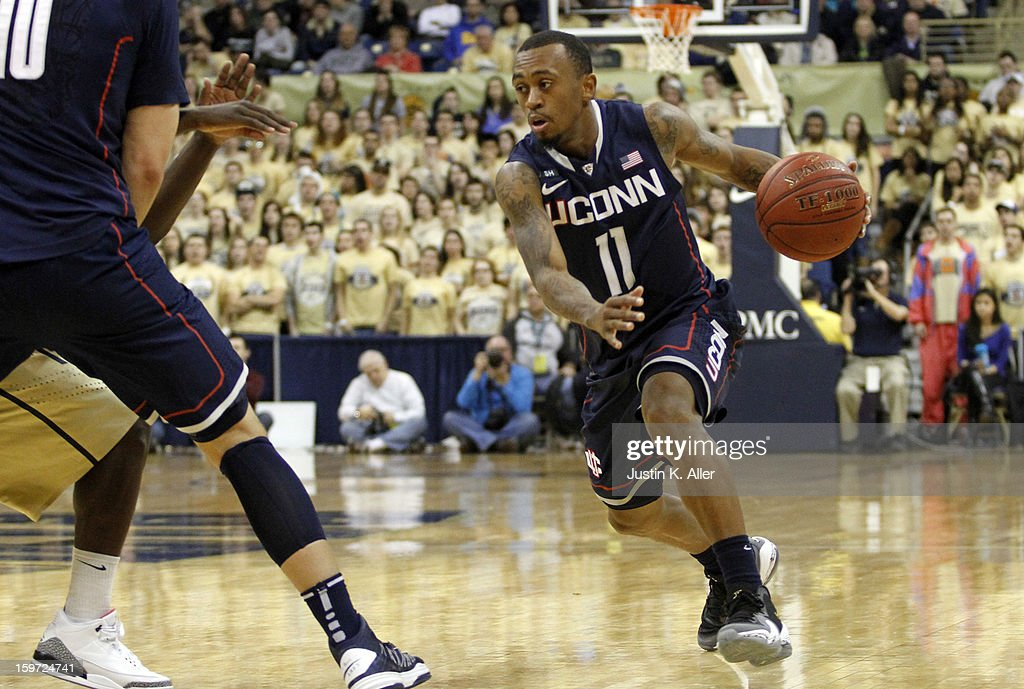 Ryan Boatright #11 of the Connecticut Huskies controls the ball against the Pittsburgh Panthers at Petersen Events Center on January 19, 2013 in Pittsburgh, Pennsylvania. PITT defeated UCONN