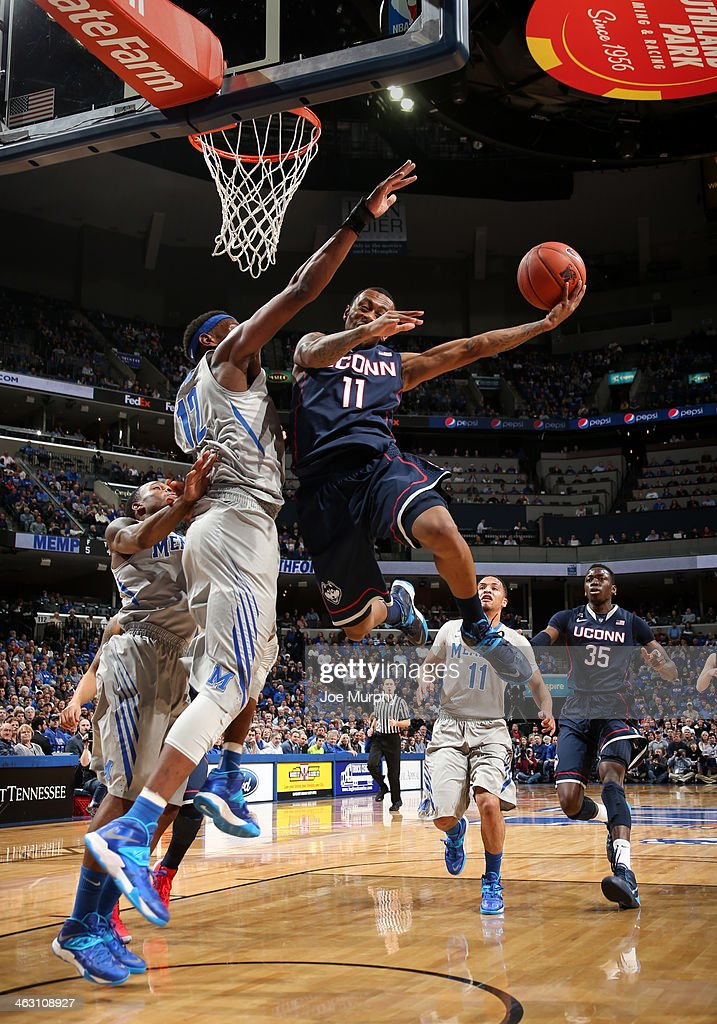 Ryan Boatright #11 of the Connecticut Huskies drives to the basket for a layup against David Pellom #12 of the Memphis Tigers on January 16, 2014 at FedExForum in Memphis, Tennessee.