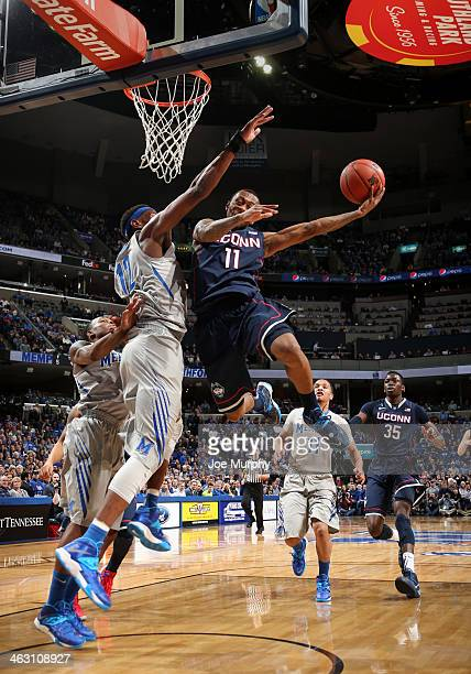 Ryan Boatright of the Connecticut Huskies drives to the basket for a layup against David Pellom of the Memphis Tigers on January 16, 2014 at...