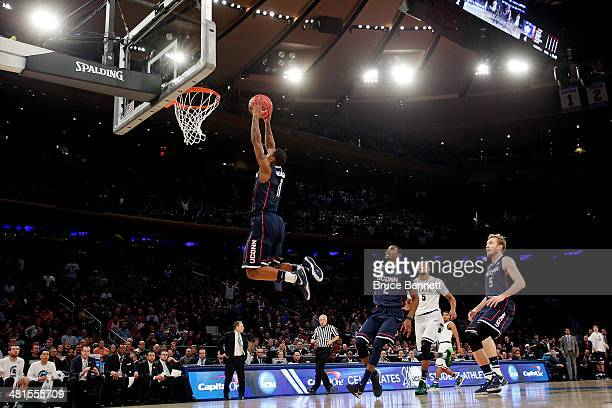 Ryan Boatright of the Connecticut Huskies dunks the ball in the first half against the Michigan State Spartans during the East Regional Final of the...